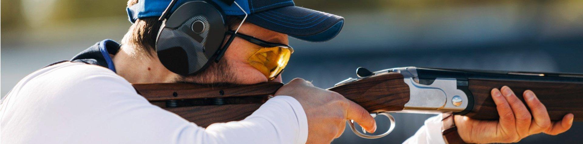 guy aiming a gun