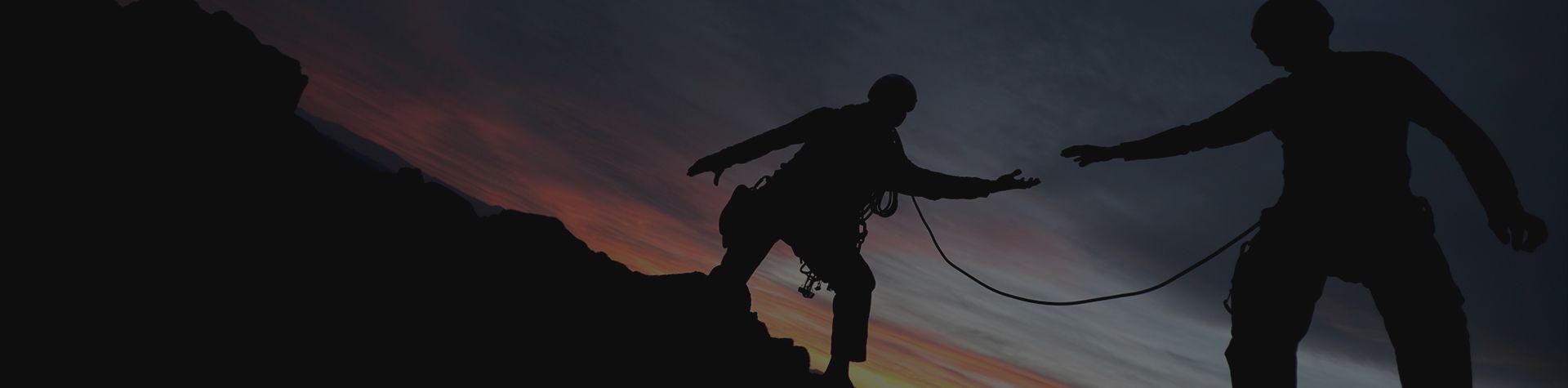 climbers walking on rocks in the dark