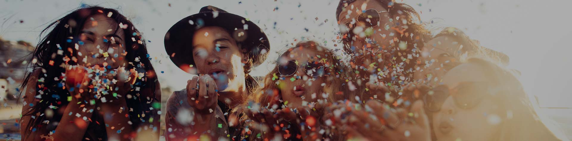 friends blowing confetti