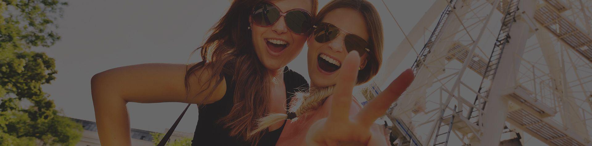 girls taking selfie outside London Eye on a hen weekend