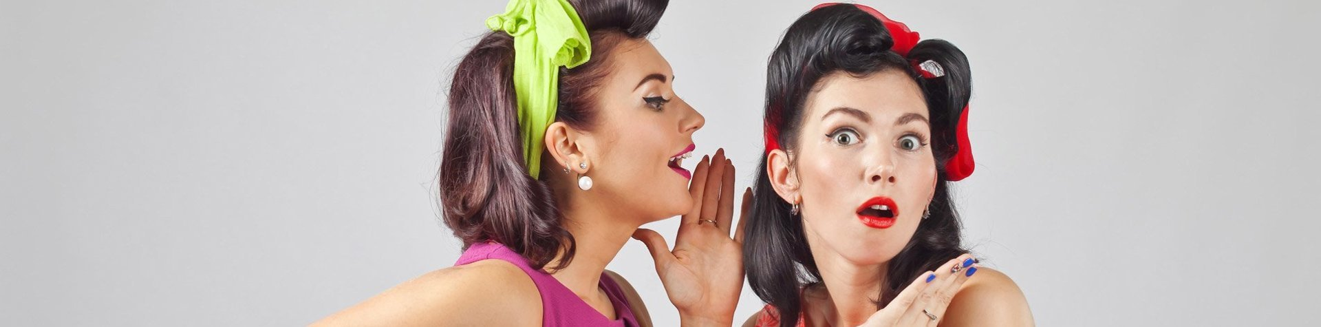 two girls styled in vintage clothing and makeup