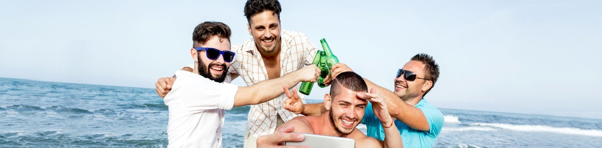 guys drinking beer on the beach
